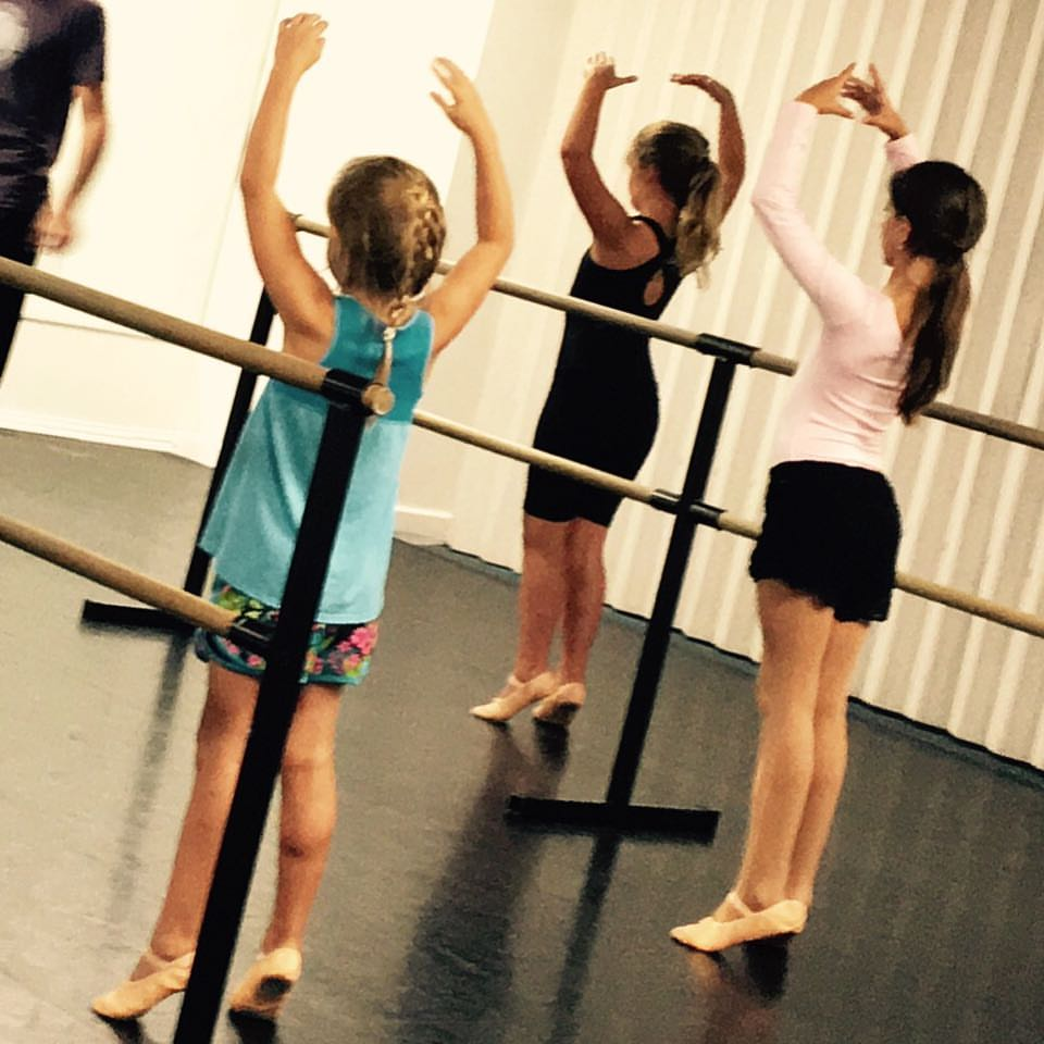 Ballet II works out at the barre